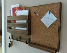 This mail organizer is perfect in rustic decor or country setting.  Stained in dark walnut and includes pint jar and three key/robe hooks.  Color may vary depending on wood selection making yours unique.  All hand made from spruce wood.  Measures 18 long and 11.25 high.  Comes with two saw tooth hangers installed on back on 16 centers.  *If you like it distressed a bit, let me know and I can add a few dings like one pictured.*