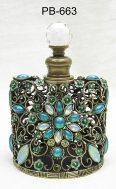 Art glass perfume bottle. Every perfume bottle I post, I think can the next one be any more Beautiful, here's another beauty!!