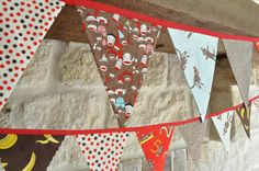 Set of 2 Sock Monkey fabric pennant banner buntings, bedroom or playroom decor, birthday party decor, photo prop. $50.00, via Etsy.