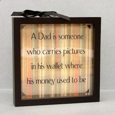 "Father's Day - Pinstripe Shadow Box idea for Dad with vinyl saying ""A Dad is someone who carries pictures in his wallet where his money used to be. Vinyl Quotes, Sign Quotes, Crafts For Kids, Diy Crafts, Fathers Day Crafts, Frame Shop, Box Frames, Homemade Gifts, Shadow Box"