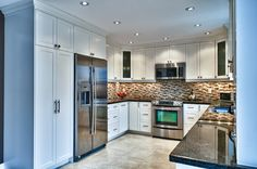 u-shaped kitchen.  Love the pantry space next to fridge.  Cabinets to the ceiling.