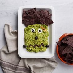 "Just call it ""FrankenGuac."" You don't have to sacrifice your favorite party snack to make it look cute for Halloween. In fact, molding your guac into the shape of Frankenstein's monster makes our handmade guacamole taste that much better. Get plating! What You'll Need: Guacamole Black olives Sour cream Blue tortilla chips Pretzels What to...Read More »"