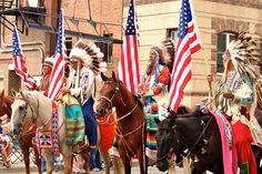 A color guard of Crow veterans led the Native American portion of the Sheridan WYO Rodeo Parade on Friday, July 10, 2015. (Gregory Nickerson/WyoFile)