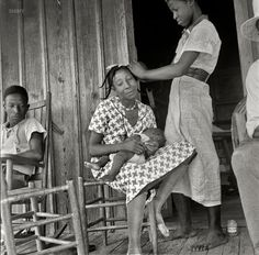 "July 1936. ""Negro women near Earle, Arkansas."" by #DorotheaLange for the #FSA. ""The product in use here is manufactured by Proline (whose name you can see on the jar). The company was later known for its commercialization of the lye-based hair relaxer, a process that had already been in use in the African #American community for decades."