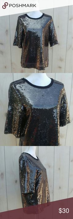 """NWT Zara sequin top Brand new with tags sequin top by Zara  Black sheer top with a sequined overlay  Sheer trim around neckline and sleeves Size XS Elbow length sleeves  100% polyester  Pit to pit 19"""" Length 25"""" Sleeves 13"""" Zara Tops Blouses"""