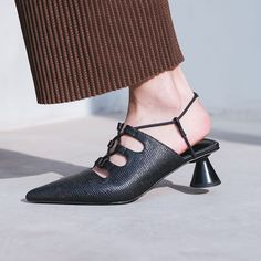 Chiko Imrich Kitten Heel Lace Up Mules feature pointy toe, lace up front, kitten heel with rubber sole.