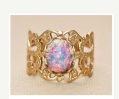 This is my favorite ring of all time.it's a antique ring,fire opal,$18.00