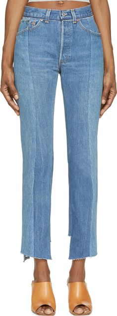 High-waisted distressed denim jeans in varying washes of light blue. Three pocket styling with mock back pockets. Frayed trim at waistband. Asymmetric cut raw hems. Relaxed slim fit. Cropped at leg. Tonal stitching.