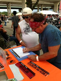 These Harley-Davidson fans are signing up for the Hupy and Abraham Biker NewsBrief.  Photo taken at the Harley-Davidson 110th Anniversary Party in Milwaukee, Wisconsin.  Sign up.    #milwaukee #harley #motorcycle #hd110