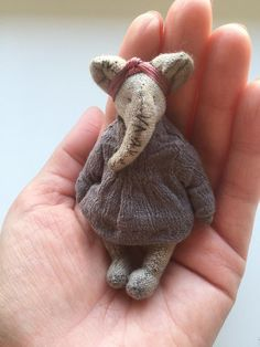 Artist toy elephant little elly by evgeniya molchanovaElly made from cotton, filled with cotton. Head and feet moving. Elly will be a good friend for your teddy bears. She will be a very nice friend for traveling in your bag. Friends for BlitheLittle Felt Crafts, Fabric Crafts, Diy Crafts, Craft Projects, Sewing Projects, Fabric Toys, Paper Toys, Tiny Dolls, Sewing Toys