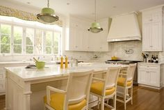 The pops of yellow brighten up this airy kitchen!  www.thestillingsgroup.com