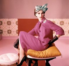 https://flic.kr/p/8NAbkv | 1961 | Model is wearing a fuscia dress suit with a green blue bow hat by Adolpho of Emme.