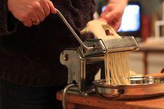 Spaghetti in the making. - someone making fresh pasta near the food spread???