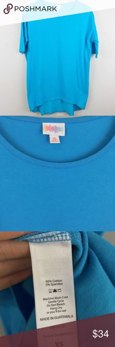 "LuLaRoe Irma Top XS T-Shirt Tunic Solid Blue LuLaRoe Irma Top XS T-Shirt Tunic Solid Blue Unicorn Womens Tee Casual Basic  22"" pit to pit 7"" sleeve 28"" length in front 31"" length in back  041018-II1-31 LuLaRoe Tops Tees - Short Sleeve"
