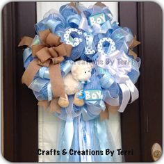 Baby Boy deco mesh wreath hospital door, shower, announcement, welcome home.... If you would like to purchase a wreath check my READY TO GO folder on my Facebook page: www.facebook.com/CraftsandCreationsByTerri or go to my Etsy page https://www.etsy.com/shop/CreatedByTerri