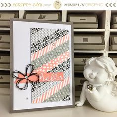hand crafted greeting card from simply graphic ... panel of diagonally placed washi tapes in black and coral ... string butterfly and hello dies ... delightful!