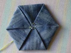 **This tutorial is intended for personal use only.** A couple of you have asked for a tutorial on how to fold a fabric hexagon yo-yo. Here ...