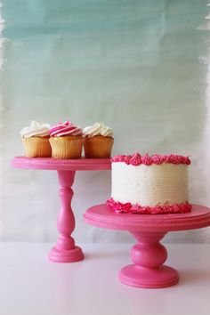 Make your own custom cake stands using wooden candle sticks and round plaques.