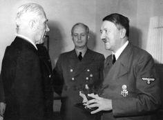 Hitler presenting das Ritterkreuz to Franz von Papen in September, 1944 as von Ribbentrop looks on blandly.
