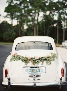 Exit Car with Eucalyptus and Rose Garland | Palm Beach Rolls Royce | Joyce & Ko Events | Judy Pak Photography https://www.theknot.com/marketplace/judy-pak-photography-new-york-ny-870194 | International Polo Club – Wellington, Florida |