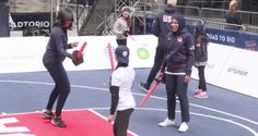 Michelle Obama learns fencing from Olympian Ibtihaj Muhammad, #BlackExcellence ensues.