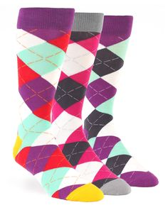 Statement Sockwear: Bold argyle featuring designs with sangria purple, seafoam green, crimson red, and golden yellow. Every 3-pack gift box provides 300 days of clean water to someone in Africa. Make a statement. Make a difference.