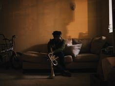 ATunde Adjuah with his reverse flugelhorn, Michele, at his apartment in Harlem.