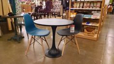 Potential coffee shop furniture style. Cool tulip table and chairs at World Market.
