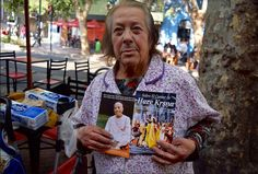 """After the Santiago, Chile Rathayatra we took a Harinama to a local University. Many Restaurants, vendors, students and tourists filled the streets. """"This simple old Street Vendor appreciated the Harinam so Visnu Jana prabhu (Harinam Ruci World SKP Party) gave her some mercy. Tears came to her eyes when she placed the On Chanting pamplets to her heart. All glories to the all merciful Srila Prabhupada!"""" Your servant, Dharmatma das"""