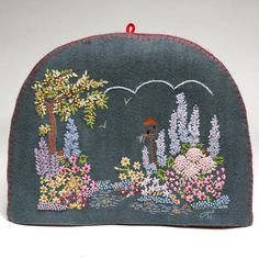 Hand Embroidered Felt Country Garden Tea Cosy by Jan Constantine.  This has a padded liner and when I make a pot of tea, this is what I use.
