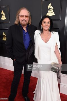 Singer-songwriter Barry Gibb of the Bee Gees (L) and Linda Gray attend The 59th GRAMMY Awards at STAPLES Center on February 12, 2017 in Los Angeles, California.