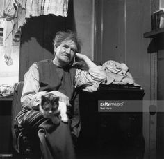 English painter, war artist, occultist and joint editor of the 'Golden Hind' art quarterly, Austin Osman Spare (1886 - 1956), at home with his cat in Brixton, South London, 1953. Original Publication: Picture Post 6627 - Austin Osman Spare - unpub - 1953