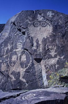 Ancient Pueblo-Anasazi rock art of a warrior with a bear claw shield - New Mexico