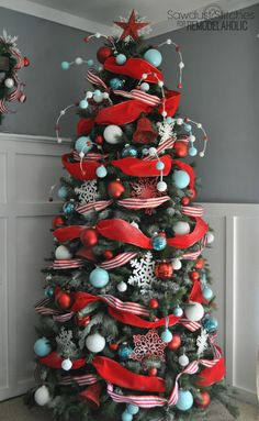 Combine a solid and striped ribbon when wrapping a skinnier tree to give it a fuller look.  See more at Remodelaholic »