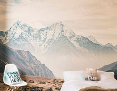 A large self-adhesive mountain vista wall mural will completely transform your room, and unlike traditional wallpaper it's quick and mess free to install.