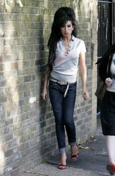 Amy in one of her trademark polo shirts with jeans and heels.