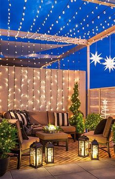 Outdoor Christmas lights make holiday magic. Use versatile string lights and LED candles on your deck, porch, patio or balcony for decoration at Christmas and throughout the year. #decorateoutdoorsstringlights