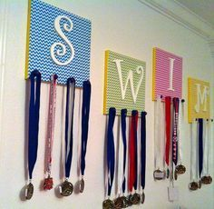 DIY Swim Medal and Accessory Holder - Easy and creative way to display your kids medals or accessories (i. jewelry, hair ribbons, etc). Works for any sport or competition. Technique is easily adaptable to make a simple holiday or general wall art. Trophy Display, Award Display, Display Wall, Swim Ribbons, Ribbon Display, Swim Mom, Medal Holders, Sport Craft, Ideas Hogar