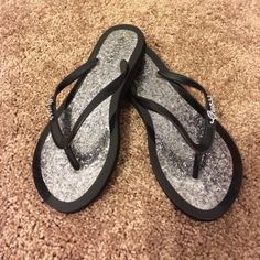 Guess Flip Flops Stylish and fun glitter guess flip-flops. Black and silver. The word Guess is detailed and rhinestones on the thong. Guess Shoes