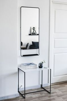 Simple black and white entry way.