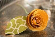 http://jonesdesigncompany.com/flowers/rolled-paper-flowers-tutorial/