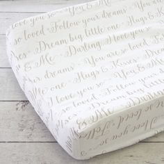 Our Love Letters collection features some of our favorite sayings for your sweet little one, written beautifully in a taupe script on a white background. This adorable changing pad cover will be sure to bring smiles to any changing table.