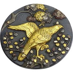 This is a lovely Shakudo stud button in mixed metal of silver, gold and copper. The bird is a detailed gold hawk and the leaves are three colors of