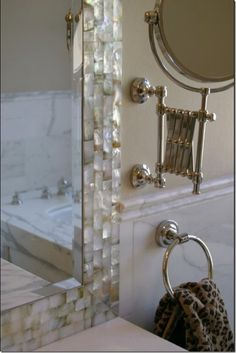 DIY to add a little something to builder grade mirrors. Could use any kind of tile.