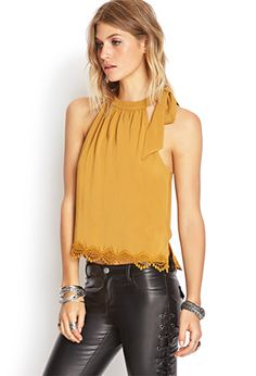 Look for Less: Kristen Taekman's Asymmetric Mustard Top http://rstyle.me/n/md622mnje