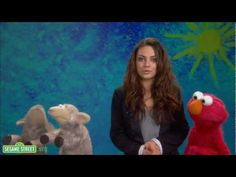 """Actor Mila Kunis demonstrates the word """"include"""" with the help of some sheep friends as part of Sesame Street's """"Word on the Street"""" in the show's 42nd season."""