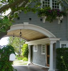 Love the idea of a carport like this.  Make it a double though.