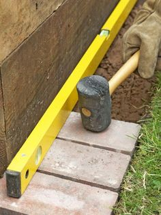 Club Hammer Firms Bricks in Mortar Place the bricks on the mortar and set slightly below the level of the turf. Leave a small gap between each. Use a spirit level to check they are horizontal, and firm them using a mallet.