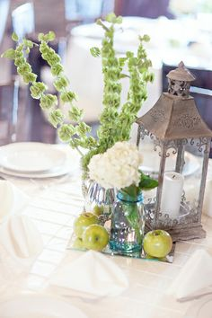Rustic Chic Country Wedding Centerpieces. I really like the tall green flowers (need to find out what they are). Ceremony decoration and cake on the site are cute too.