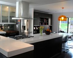 """Complete kitchen remodel, long island, white quartz ceasarstone countertops""""  """"use of alumina glass doors, dark & white surfaces"""""""